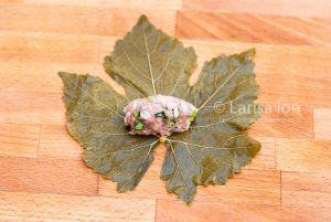Steps of cooking dolma(tolma, sarma) from grape leaves stuffed with minced meat and rice.