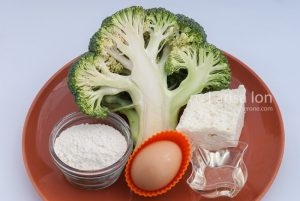 Cooking ingredients: fresh broccoli, brinza cheese, egg, sunflower oil and flour