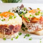 Eggs baked in ham cups garnish with green peas fried with spinach