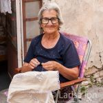 Old woman embroidering lefkaritika, traditional handmade lace. Lefkara. Cyprus.
