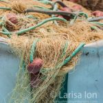 Colorful fishing nets in basket closeup