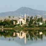 Sultan Tekke Mosque near Larnaca in Cyprus view from across the Salt Lake on sunrise