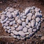 Heart made from pebbles on the beach
