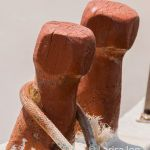 old wooden fishing boat cleats with rope wrapped around.